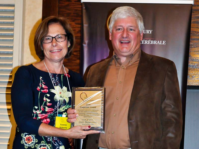 John Zehr accepts the award from Suzanne McKenna, Board Member of Brain Injury Canada