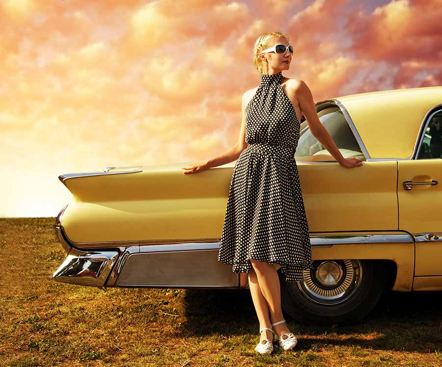 Retro lady in front of vintage car